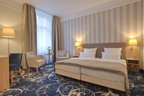 zimmer suiten im sterne hotel in karlsruhe. Black Bedroom Furniture Sets. Home Design Ideas